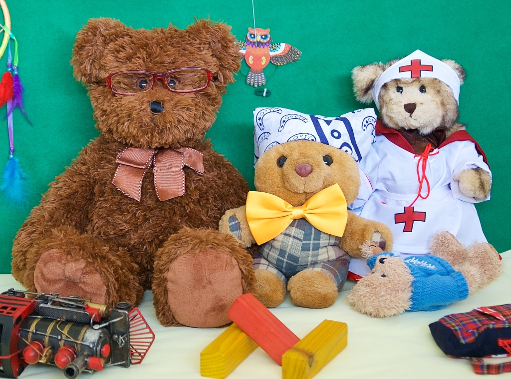 Me Scotland The Brave sitting with Dr Caddy and Nurse Bree. I am holding my own Little Teddy.
