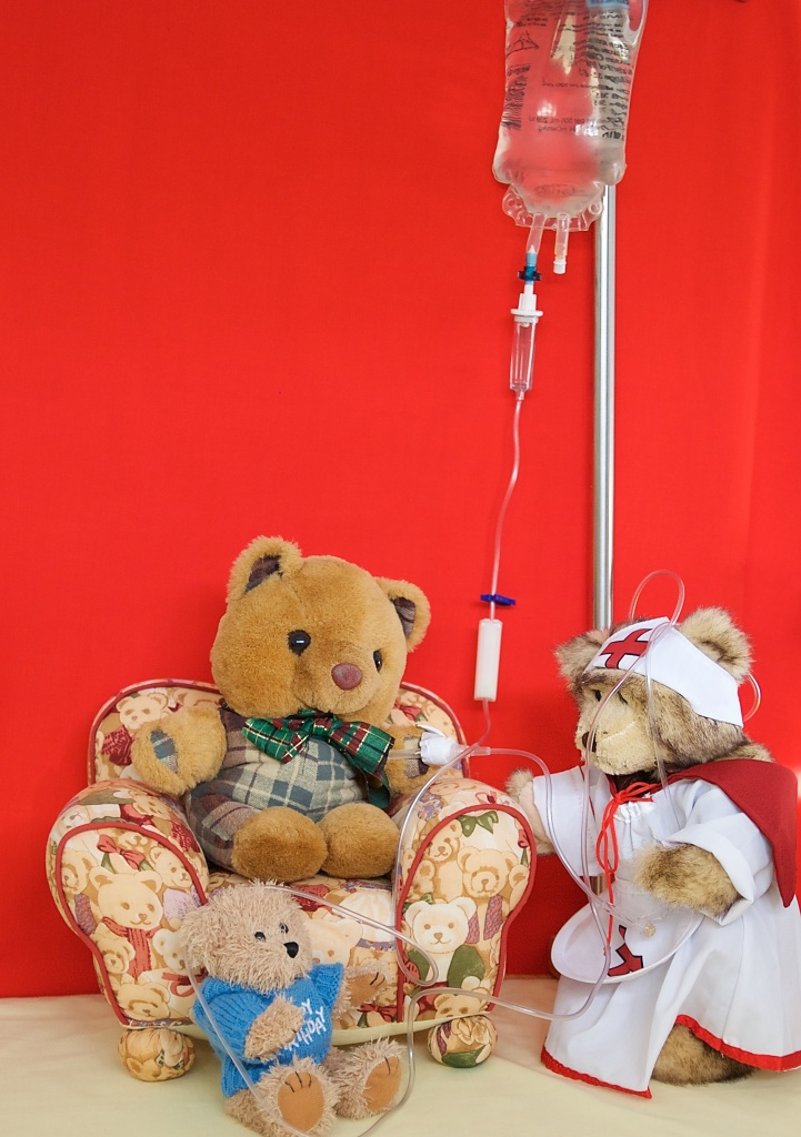 Nurse Bree attaches the drip line to Scotty but Little Teddy tangles her up with the line.